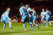 Jean-Yves Mvoto of Barnsley (2nd left) celebrates scoring the opening goal with Chris O'Grady of Barnsley (3rd left) during the Sky Bet Championship match at The Valley, London<br /> Picture by David Horn/Focus Images Ltd +44 7545 970036<br /> 15/04/2014