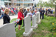 Milpitas City Council officials place wreaths at the various war memorials during the Memorial Day Ceremony at City Hall in Milpitas, California, on May 25, 2015. (Stan Olszewski/SOSKIphoto)