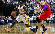 March 14, 2012; Indianapolis, IN, USA; Indiana Pacers point guard Darren Collison (2) dribbles the ball against Philadelphia 76ers center Nikola Vucevic (8) at Bankers Life Fieldhouse. Indiana defeated Philadelphia 111-94. Mandatory credit: Michael Hickey-US PRESSWIRE
