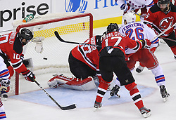 May 25, 2012; Newark, NJ, USA; New York Rangers left wing Ruslan Fedotenko (26) scores a goal on New Jersey Devils goalie Martin Brodeur (30) during the second period in game six of the 2012 Eastern Conference finals at the Prudential Center.