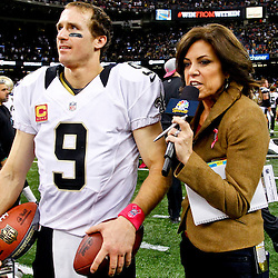 October 7, 2012; New Orleans, LA, USA; NBC sideline reporter Michele Tafoya interviews New Orleans Saints quarterback Drew Brees (9) after a win over the San Diego Chargers and breaking Johnny Unitas NFL record for consecutive games with a touchdown at the Mercedes-Benz Superdome. The Saints defeated the Chargers 31-24. Mandatory Credit: Derick E. Hingle-US PRESSWIRE