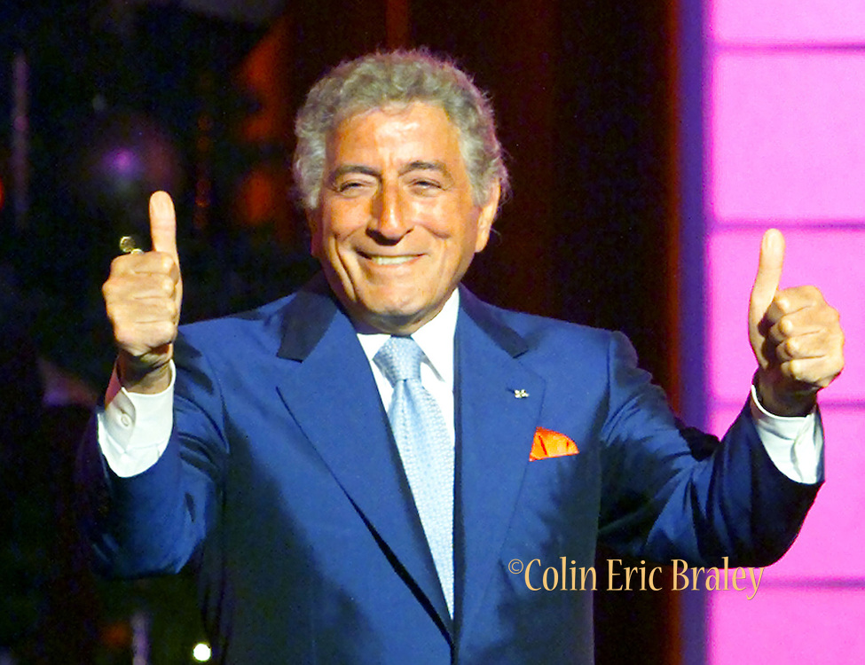"Singer Tony Bennett thanks his fans after singing ""Who Can I Turn To"" October 25, 2000 during the taping of ""The American Red Cross Holiday Music Spectacular from Miami"" at The Jackie Gleason Theater in Miami Beach, Florida. The show was broadcasted on the Fox network on December 23, 2000."