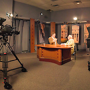 Inside a public television station studio in Charlottesville, Virginia, during the taping of a public affairs interview.