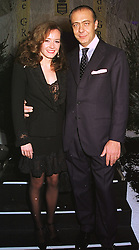 MR & MRS FAWAZ GRUOSI the leading jewellers, at a party in London on 9th December 1998.MMU 14