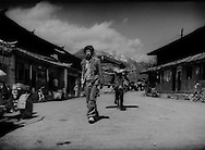 Naxi man leads his pony into the village of Baisha beneath the Jade Dragon Snow Mountain massif in 1997.  Near Lijiang, Yunnan, China.