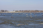 Lake Michigan's Green Bay is one of the premiere walleye fisheries in the United States. Walleye fishing activity greatly accelerates during the annual spring spawning period, as the fish move from the bay into the rivers to spawn. This image illustrates the sheer number of avid walleye anglers who maneuver their boats for position on the Fox River, just downstream of the De Pere Dam.