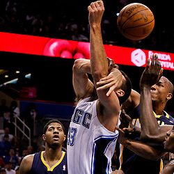 March 11, 2012; Orlando, FL, USA; Orlando Magic power forward Ryan Anderson (33) is fouled under the basket by Indiana Pacers power forward David West (21) during the first quarter of a game at  Amway Center.   Mandatory Credit: Derick E. Hingle-US PRESSWIRE
