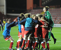 Players celebrate Bristol Academy's nail biting win over FC Barcelona at Ashton Gate - Photo mandatory by-line: Paul Knight/JMP - Mobile: 07966 386802 - 13/11/2014 - SPORT - Football - Bristol - Ashton Gate Stadium - Bristol Academy v FC Barcelona - UEFA Women's Champions League
