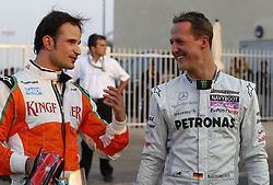 Motorsports / Formula 1: World Championship 2010, GP of Abu Dhabi, 15 Vitantonio Liuzzi (ITA, Force India F1 Team), 03 Michael Schumacher (GER, Mercedes GP Petronas),