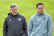 Heart of Midlothian manager Craig Levein (dark jacket) and coach Jon Daly during training at the Oriam Sports Performance Centre, Edinburgh on 13 September 2018, ahead of the away match against Motherwell.