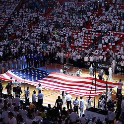 Jun 6, 2013; Miami, FL, USA; The American flag is displayed across the court prior to the start of game one between the San Antonio Spurs and the Miami Heat in the 2013 NBA Finals at the American Airlines Arena. Mandatory Credit: Derick E. Hingle-USA TODAY Sports