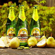 Beauty bottles, pears and bottle caps on a table Ray Massey is an established, award winning, UK professional  photographer, shooting creative advertising and editorial images from his stunning studio in a converted church in Camden Town, London NW1. Ray Massey specialises in drinks and liquids, still life and hands, product, gymnastics, special effects (sfx) and location photography. He is particularly known for dynamic high speed action shots of pours, bubbles, splashes and explosions in beers, champagnes, sodas, cocktails and beverages of all descriptions, as well as perfumes, paint, ink, water – even ice! Ray Massey works throughout the world with advertising agencies, designers, design groups, PR companies and directly with clients. He regularly manages the entire creative process, including post-production composition, manipulation and retouching, working with his team of retouchers to produce final images ready for publication.