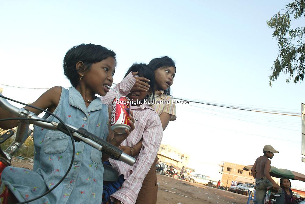 SIEM REAP, NOVEMBER-28:  girls sit on a bicycle in Siem Reap, November 28, Cambodia.