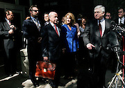 Former Enron chairman Kenneth Lay (C) stands with his legal team and family outside of the Bob Casey U.S. Courthouse following proceedings in his fraud and conspiracy trial, May 16, 2006, in Houston. The defense presented it's closing arguments in the trial that has spanned 16 weeks. (Photo by Dave Einsel)