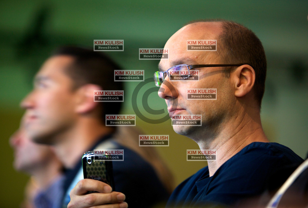 Andy Rubin, senior vice president of mobile  at Google Inc., checks his Android smartphone at the Google I/O  developer's conference in San Francisco, California.