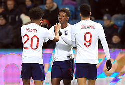 England U21's Demarai Gray (centre) celebrates scoring his side's first goal of the game with Reiss Nelson (left) and Dominic Solanke during the international friendly match at the Blue Water Arena, Esbjerg.