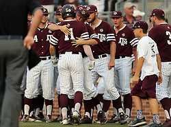 Texas A&M's J.B. Moss (11) is swarmed by teammates after hitting a home run against TCU during the first inning of a NCAA college baseball Super Regional tournament game, Saturday, June 11, 2016, in College Station, Texas. (AP Photo/Sam Craft)