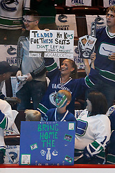 June 10, 2011; Vancouver, BC, CANADA; A Vancouver Canucks fan holds up a sign before game five of the 2011 Stanley Cup Finals against the Boston Bruins at Rogers Arena. Vancouver defeated Boston 1-0. Mandatory Credit: Jason O. Watson / US PRESSWIRE