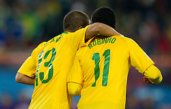 Dani Alves and Robinho of Brazil celebrate after Juan scored during the 2010 FIFA World Cup South Africa Round of Sixteen match between Brazil and Chile at Ellis Park Stadium on June 28, 2010 in Johannesburg, South Africa.  (Photo by Vid Ponikvar / Sportida)