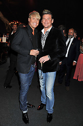 Left to right, GARY COCKERILL and PHIL TURNER at the inaugural Gabrielle's Gala in London in aid of Gabrielle's Angel Foundation for Cancer Research held at Battersea Power Station, London on 7th June 2012.