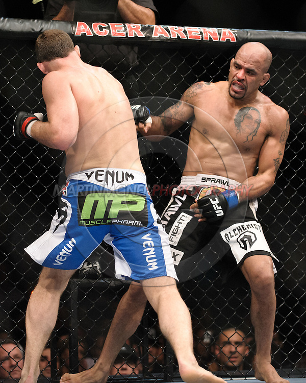 "SYDNEY, AUSTRALIA, FEBRUARY 27, 2011: Jorge Rivera (facing) is rocked by a punch from Michael Bisping during ""UFC 127: Penn vs. Fitch"" inside Acer Arena in Sydney, Australia on February 27, 2011."