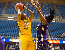 West Virginia Mountaineers guard Breana McDonald (20) shoots along the baseline against the TCU Horned Frogs at the WVU Coliseum.