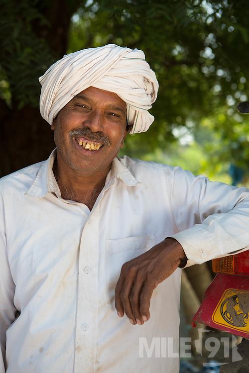 A cotton farmer, India.