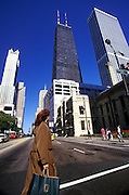 Image of a shopper on North MIchigan Avenue along the Magnificent Mile in Chicago, Illinois, American Midwest, model released