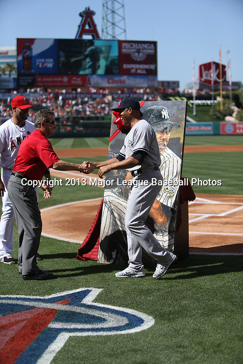 ANAHEIM, CA - JUNE 15:  Mariano Rivera #42 of the New York Yankees shakes hands with Los Angeles Angels of Anaheim owner Arte Moreno during a tribute to the pitcher before the game against the Los Angeles Angels of Anaheim on Saturday, June 15, 2013 at Angel Stadium in Anaheim, California. The Angels won the game 6-2. (Photo by Paul Spinelli/MLB Photos via Getty Images) *** Local Caption *** Mariano Rivera;Arte Moreno