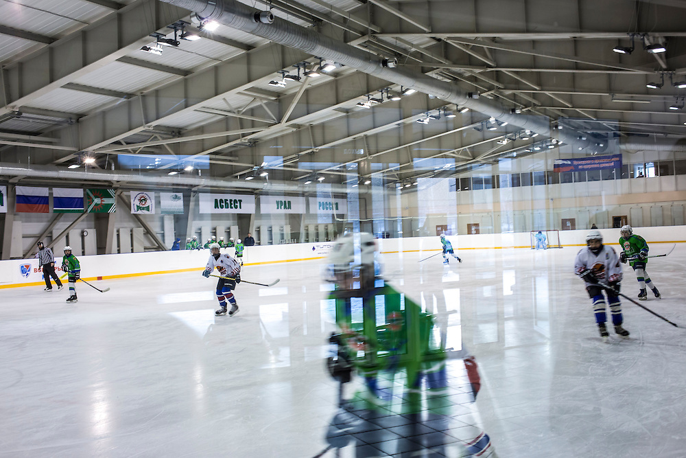 Chrysotile, a local youth hockey team, plays a game against a local rival on Sunday, December 1, 2013 in Asbest, Russia. The team is named for chrysotile asbestos, the type mined from a quarry in the town.