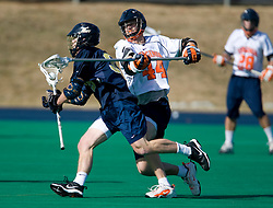 Virginia defenseman Mike Timms (44) checks Navy midfielder Shane Durkin (35).  The Virginia Cavaliers scrimmaged the Navy Midshipmen in lacrosse at the University Hall Turf Field  in Charlottesville, VA on February 2, 2008.