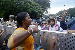 August 29, 2017 - Kolkata, West Bengal, India - Woman activist clash with police as police block their roads during the rally in Kolkata. Activist of Chit fund depositors and agent forum hold a rally popularly called ''Nabana Abhijan'' demanding government to takes initiative to return their money and security on August 29, 2017 in Kolkata. (Credit Image: © Saikat Paul/Pacific Press via ZUMA Wire)