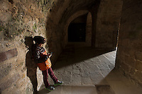 A young boy finds his iPod more interesting than the ancient French monastery of Mont San Michel off the coast of Normandy, France