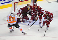 Dec. 3 2011; Glendale, AZ, USA; Philadelphia Flyers forward Claude Giroux (28) shot is blocked by Phoenix Coyotes forward Boyd Gordon (15) as defensemen Derek Morris (53) and goalie Jason LaBarbera (1) look on during the third period at Jobing.com Arena. The Flyers defeated the Coyotes 4-2. Mandatory Credit: Jennifer Stewart-US PRESSWIRE.