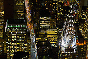 Photo of the Chrysler building taken from a helicopter at night by photographer Evan Joseph.