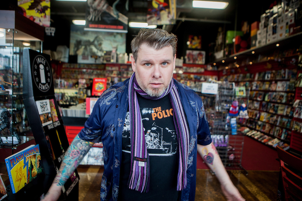 STATEN ISLAND, NY - MARCH 3, 2015:   Socko Jones, owner of Comic Book Jones, poses for a portrait in his store on Staten Island.