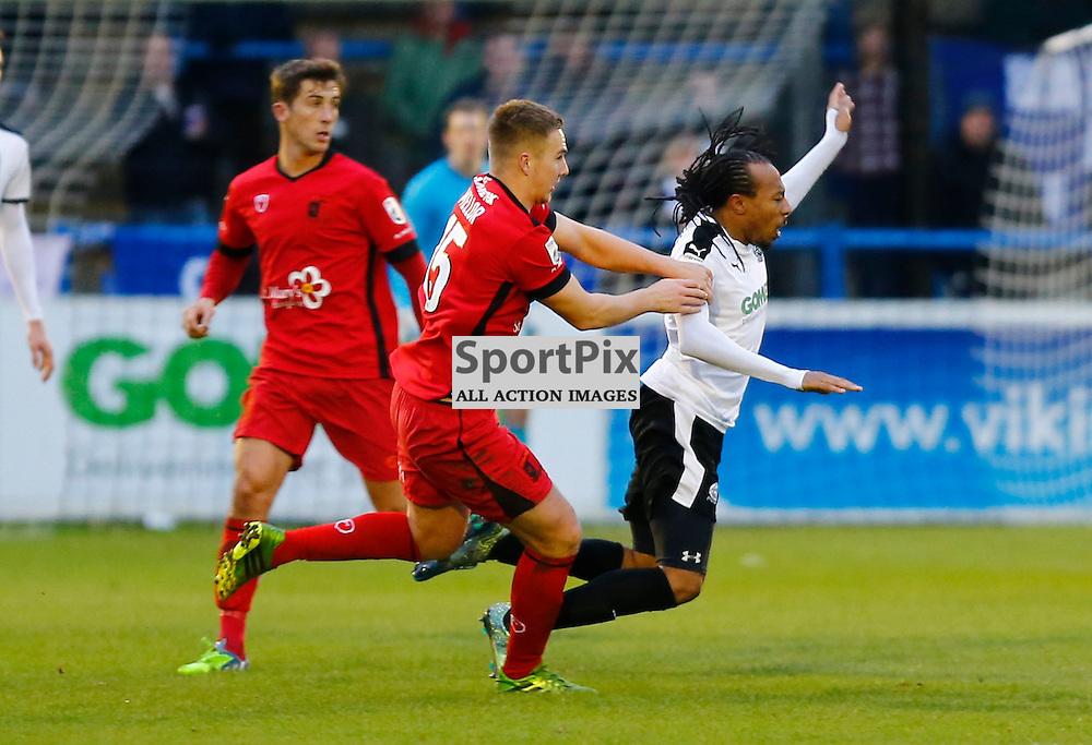 Barrow's midfielder David Mellor (15) pulls Dover's winger Ricky Modests (7) to the ground. Dover Athletic v Barrow. Vanarama National League. 10  November 2015. (c) Matt Bristow | SportPix.org.uk