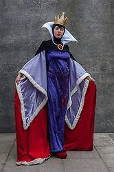 © Licensed to London News Pictures. 24/05/2015. London, UK. A girl dressed as the Evil Queen from Snow White poses, as fans of anime, comic books, video games and more gather in large numbers at the Excel Centre to attend the bi-annual MCM Comic Con. Photo credit : Stephen Chung/LNP