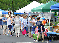 Customers fill the newly located newly located Perkasie Farmers Market Saturday June 20, 2015 in Perkasie, Pennsylvania.The farmers market relocated because of construction at the old site.  (Photo by William Thomas Cain)