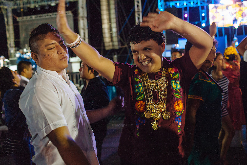 """Angelo Martinez Linares, 24, during the annual party known as the Muxe Candle in Juchitán, Mexico.<br /> <br /> In Juchitán in the southern state of Oaxaca, Mexico, the world is not divided simply into gay and straight, the locals make room for a third category, whom they call """"muxes"""".<br /> <br /> Muxes are men who consider themselves women and live in a socially sanctioned netherworld between the two genders. """"Muxe"""" is a Zapotec word derived from the Spanish """"mujer"""" or woman; it is reserved for males who, from boyhood, have felt themselves drawn to living as a woman, anticipating roles set out for them by the community.<br /> <br /> They are considered hard workers that will forever stay by their mothers side, taking care for their families operating as mothers without children of their own.<br /> <br /> Not all muxes express they identities the same way. Some dress as women and take hormones to change their bodies. Others favor male clothes. What they share is that the community accepts them."""