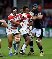 Kotaro Matsushima of Japan is tackled - Mandatory byline: Patrick Khachfe/JMP - 07966 386802 - 23/09/2015 - RUGBY UNION - Kingsholm Stadium - Gloucester, England - Scotland v Japan - Rugby World Cup 2015 Pool B.