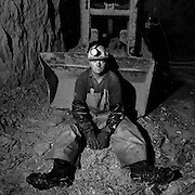 Steve Allen sitting in front of a CAVO 320 mucking machine, 1450 foot level, Kerr Mine, Virginiatown, Ontario. From the book Cage Call: Life and Death in the Hard Rock Mining Belt. An in-depth project spanning over 12-years examining communities in one of the richest mining regions in the world located in Northwestern Ontario and Northeastern Quebec in Canada.