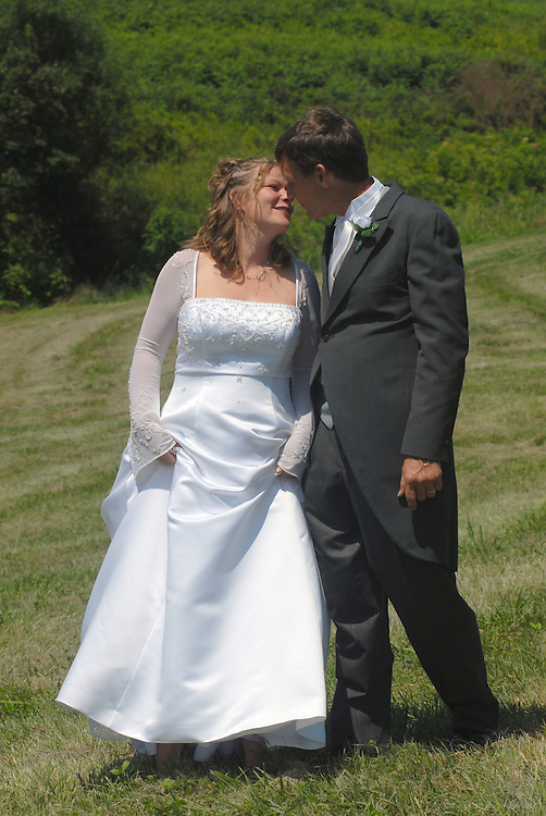 The wedding of Victoria and Rick, July 2006, Waddy, Ky. .© 2006 Brian Bohannon.