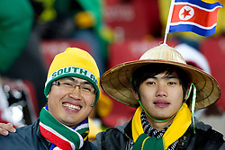 Football - soccer: FIFA World Cup South Africa 2010, Brazil (BRA) - Korea DPR (PRK), Korea DPR fans enjoys the atmosphere ahead of the 2010 FIFA World Cup South Africa Group G match between Brazil and North Korea at Ellis Park Stadium on June 15, 2010 in Johannesburg, South Africa.