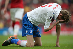Stoke City's Peter Crouch holds his head after a challenge