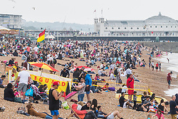 © Licensed to London News Pictures. 28/05/2017. Brighton, UK. Members of the public brave the grey clouds to spent some time on the beach in Brighton and Hove on the Bank holiday weekend. Photo credit: Hugo Michiels/LNP