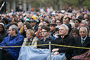 Family and friends bundle up in blustery conditions at the University of Rochester's Commencement ceremony in Rochester on Sunday, May 15, 2016.