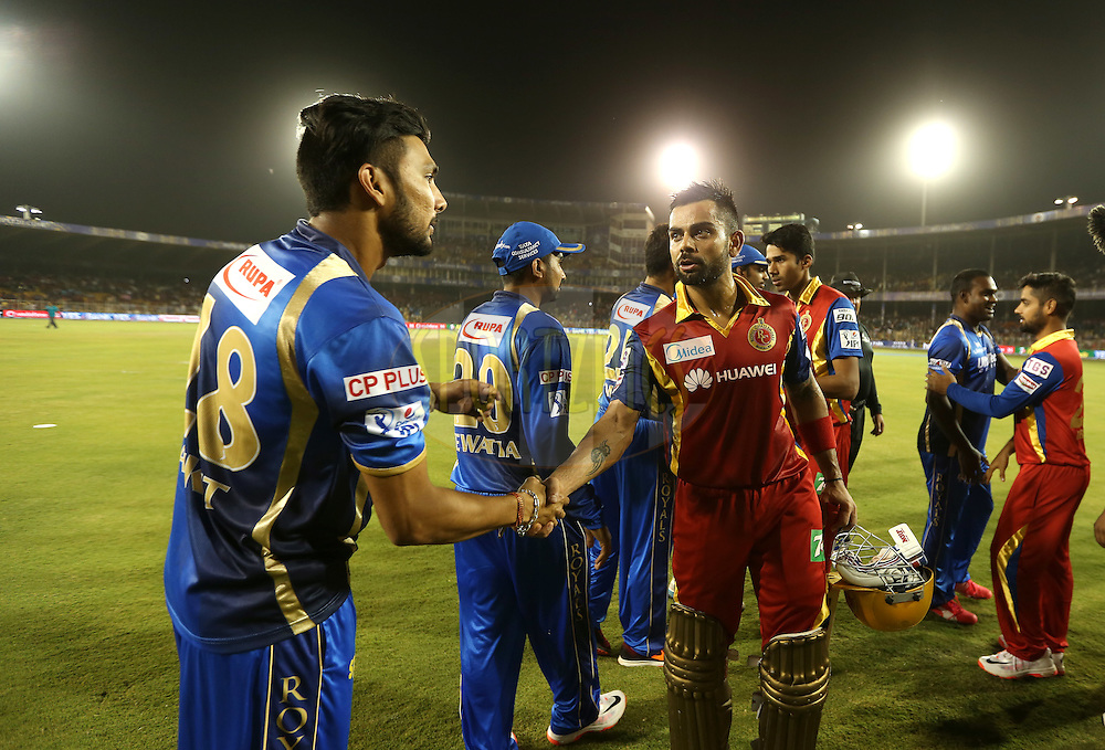 Royal Challengers Bangalore captain Virat Kohli shake hands after winning the  match 22 of the Pepsi IPL 2015 (Indian Premier League) between The Rajasthan Royals and The Royal Challengers Bangalore held at the Sardar Patel Stadium in Ahmedabad , India on the 24th April 2015.<br /> <br /> Photo by:  Sandeep Shetty / SPORTZPICS / IPL