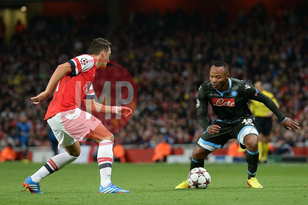 LONDON, ENGLAND - Oct 01: Arsenal's midfielder Mesut Ozil from Germany and Napoli's defender Camilo Zuniga from Columbia during the UEFA Champions League match between Arsenal from England and Napoli from Italy played at The Emirates Stadium, on October 01, 2013 in London, England. (Photo by Mitchell Gunn/ESPA)