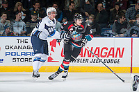 KELOWNA, CANADA - DECEMBER 3: Nelson Nogier #55 of Saskatoon Blades checks Tomas Soustal #15 of Kelowna Rockets on December 3, 2014 at Prospera Place in Kelowna, British Columbia, Canada.  (Photo by Marissa Baecker/Shoot the Breeze)  *** Local Caption *** Nelson Nogier; Tomas Soustal;